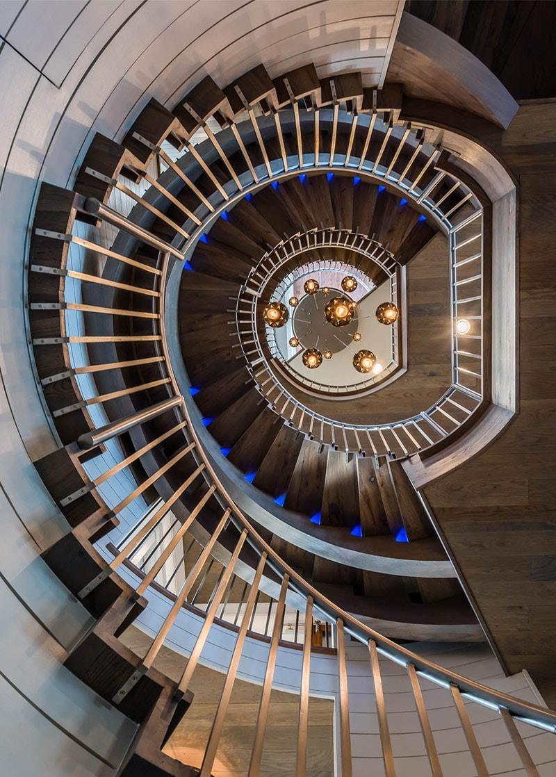 Custom spiral staircase and home interior design by Sugar Beach Interiors, Santa Rosa Beach, Florida, Watercolor.