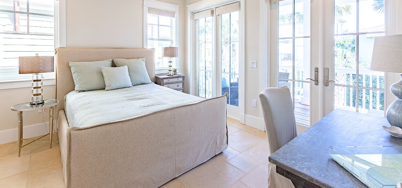 Sugar Beach Interiors, Miramar Beach, Florida. White coastal bedroom