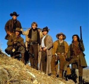 cast of Young Guns Emilio Estevez, Charlie Sheen, Kiefer Sutherland, Casey Siemaskzo, Charlie Sheen, Dermot Mulroney, Lou Diamond Phillips