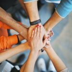 Team Work - Several people with hands together.