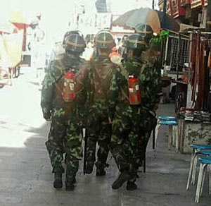 People's Armed Police carrying fire-extinguishers in Lhasa.