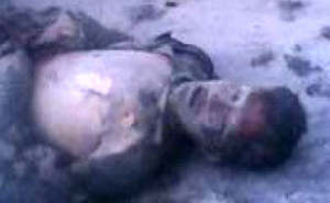 Yangdang, who fell on the ground, badly burnt, after his self-immolation.