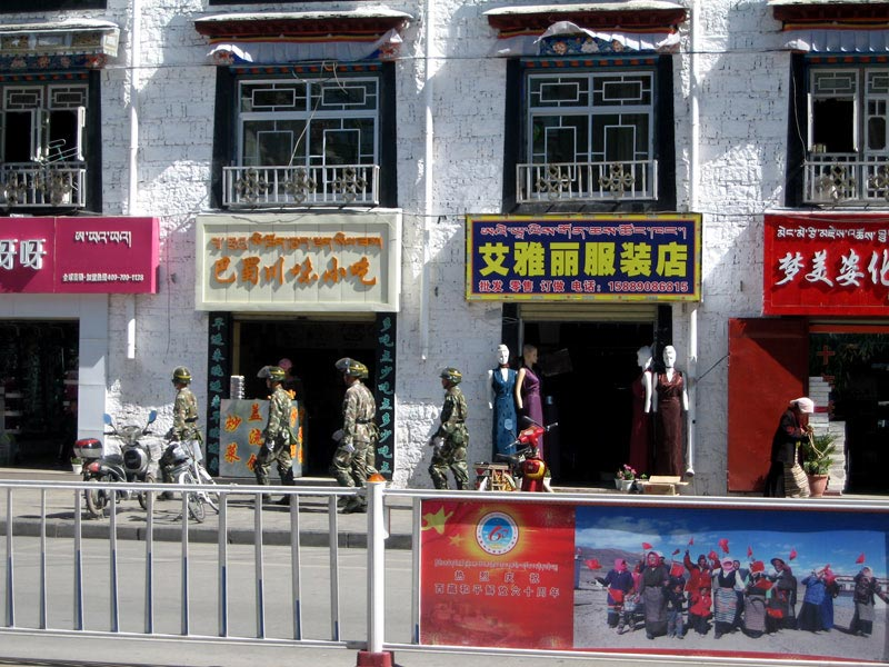 Security personnel patrolling the streets of Lhasa.