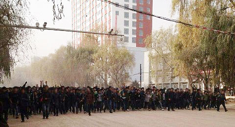 Schoolchildren and students demonstrate