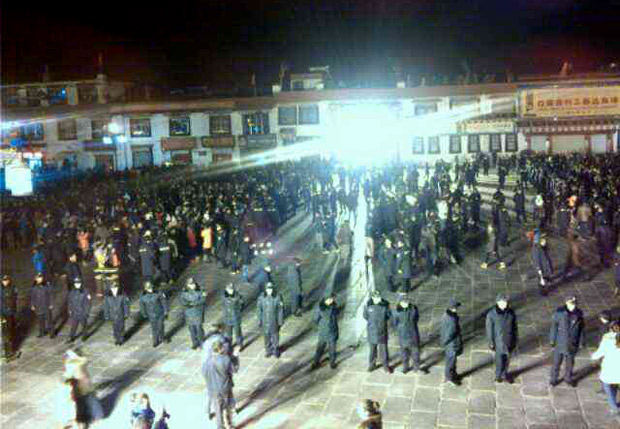 Image obtained from Lhasa show troops and firemen massed outside the Jokhang temple