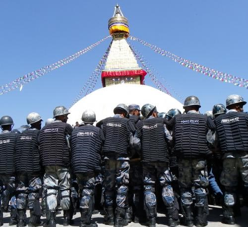 Hundreds of police in riot gear gathered around key Tibetan centers
