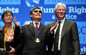 Chen Guangcheng, with his wife Yuan Weijing and ICT Board Chair Richard Gere