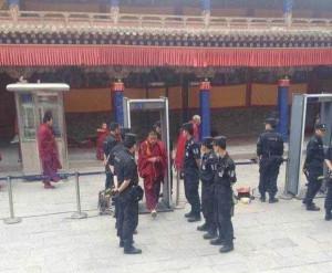 Police man the security gates at Kumbum monastery