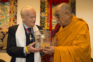His Holiness the Dalai Lama presenting Robert Ford with ICT's Light of Truth Award in April 2013.