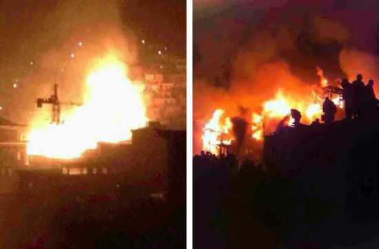 A fire broke out in the monastic encampment of Larung Gar (Serthar) in eastern Tibet January 9, 2014 during the evening. According to Tibetans in the area who posted the photos on social media, at least 100 homes of nuns living at the religious complex were burnt down. Images showed plumes of smoke against the night sky arising from a massive blaze that spread quickly among the modest wooden dwellings of the nuns. There were fears that the fire will spread to the main temple. Details of circumstances remained sketchy and there has been no information about anyone injured in the blaze. The sprawling hillside settlement of Larung Gar, home to Serthar Buddhist Institute in Kardze (Ch: Ganzi) prefecture in Sichuan, is one of the largest and most important religious sites in Tibet (see images at here).