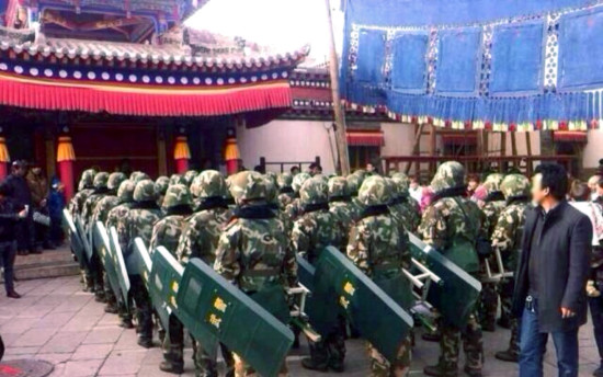 Troops with riot shields gathering at Kumbum for the Monlam prayer festival