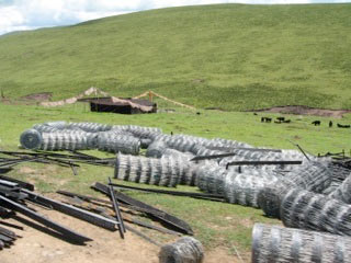 Bales of fencing in Kham, Tibet, in preparation for enclosing an area of grassland under nomad settlement policies.