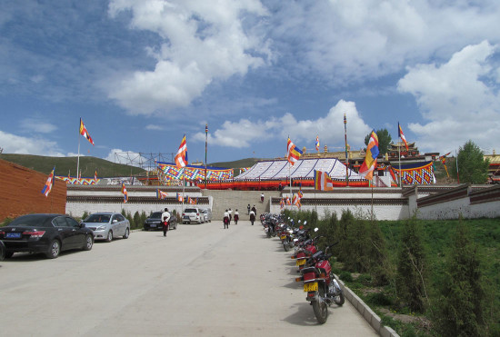 A traditional tent and Buddhist flags flying in Tsoe monastery the week before the Kalachakra teachings.