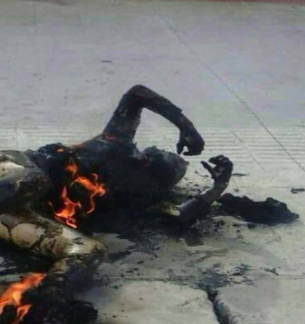 The body of a woman who self-immolated in a town center in Ngaba (Chinese: Aba).