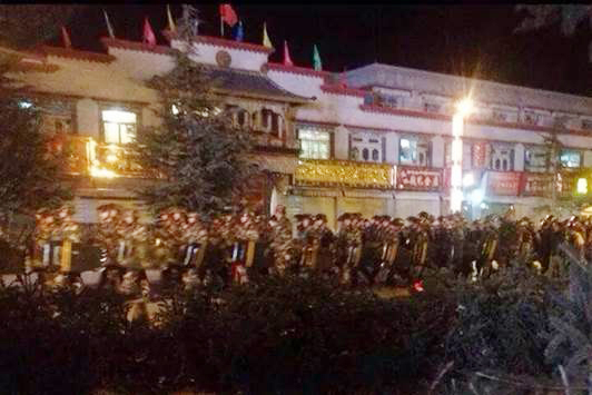 Paramilitary troops in riot gear patrol in the Barkhor area, Lhasa, on December 15, the eve of the Tsongkhapa 'butter-lamp' festival.