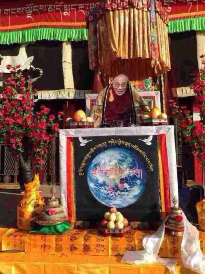 An image of the Dalai Lama is boldly displayed