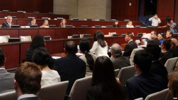 A panel of Chinese, Tibetan, and Uyghur experts in front of CECC members during the hearing.