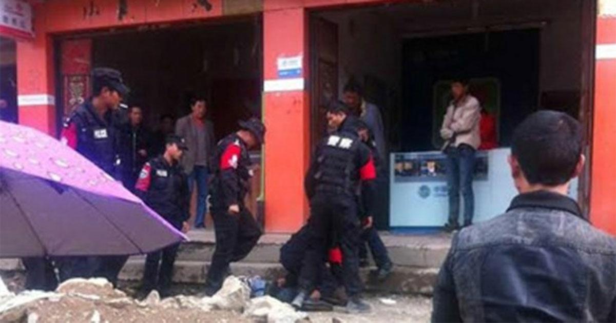 Police detain a Tibetan protester