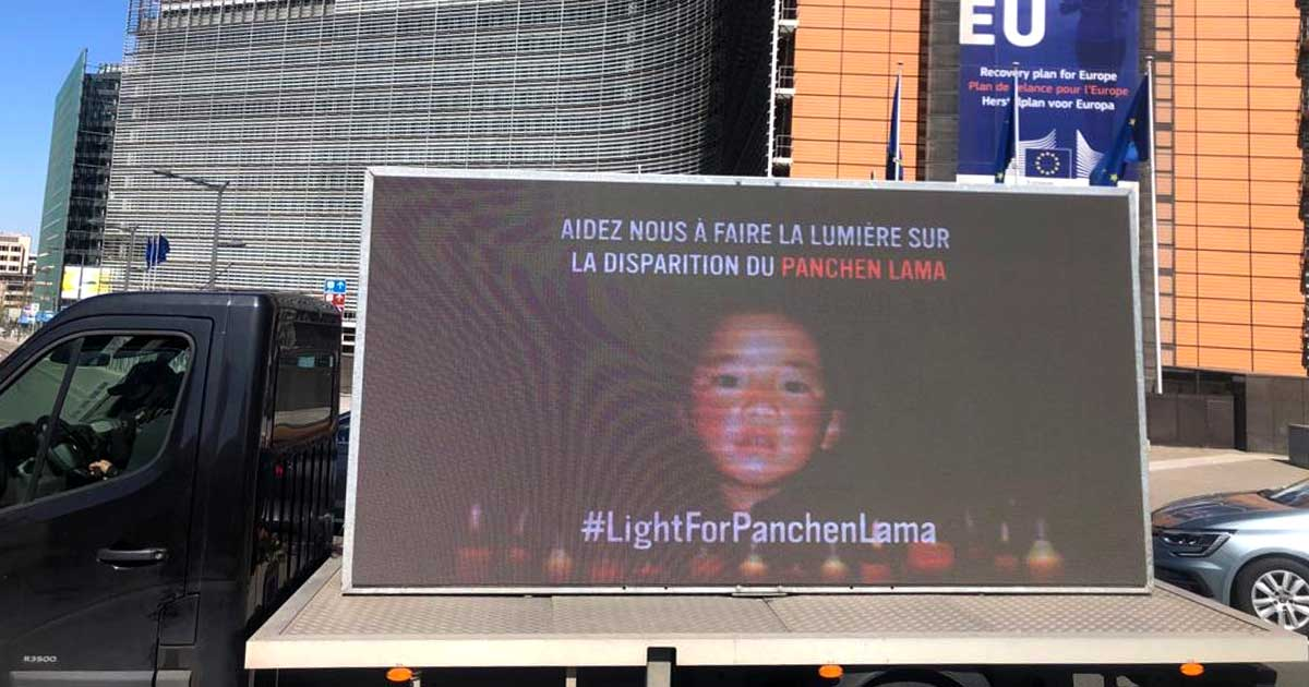 truck showing pictures of the Panchen Lama