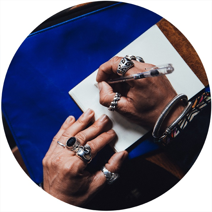 man-with-rings-writing
