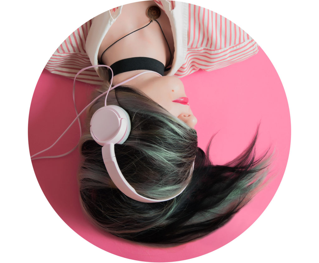 Girl with Headphones on pink background