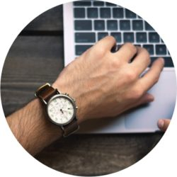 Man's Hand Typing Checking Time