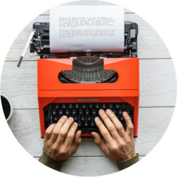 Man Typing on red typewriter