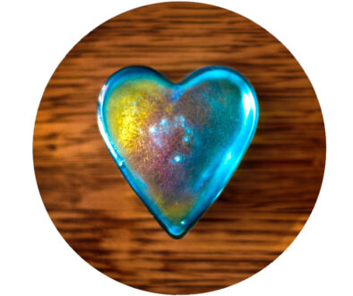 blue glass heart on wooden background