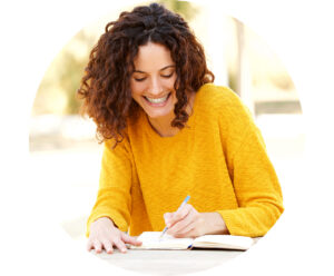 Woman Smiling and Journaling Writing