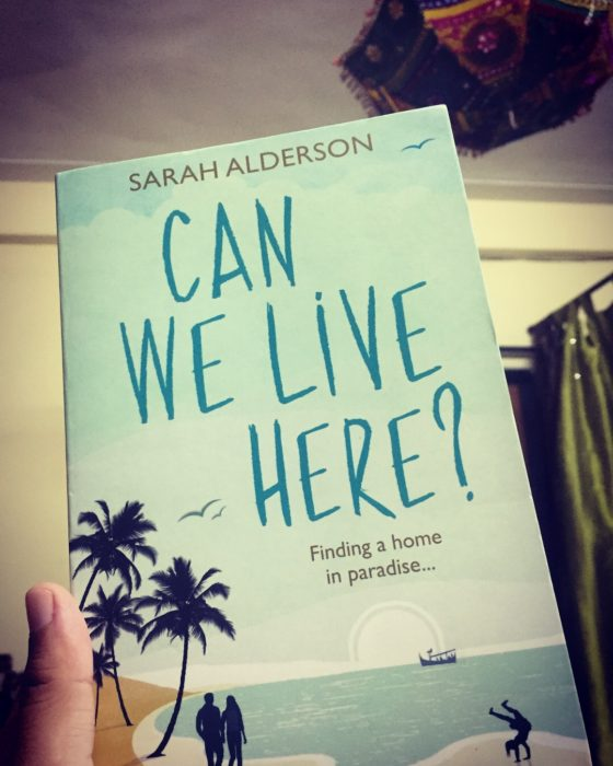 When I am not traveling, I can be found reading a travelogue :D Can We Live Here by Sarah Alderson