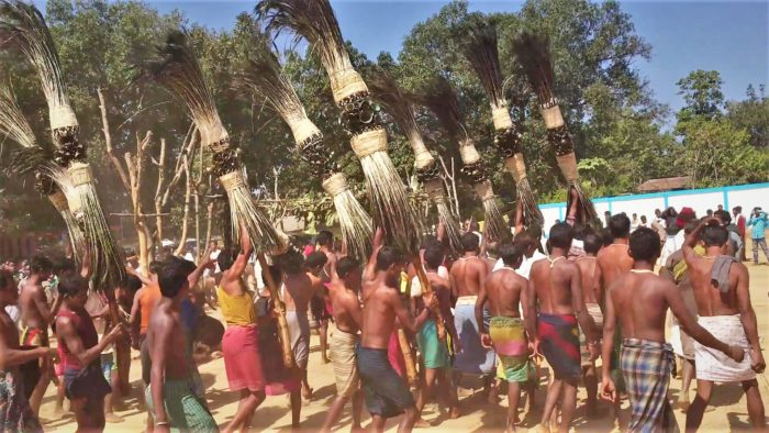 Tribals dancing and playing with the local deities during Ghotpal Madai.