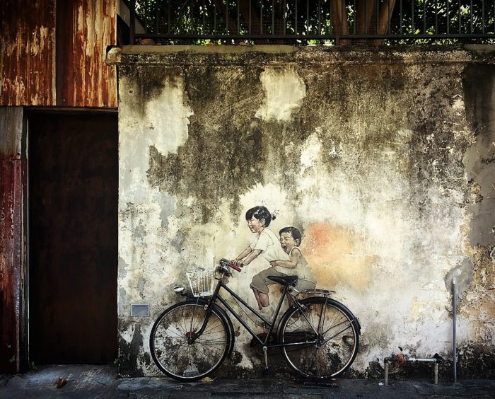 Travel like a local: Exploring the street art in the by-lanes of the old George Town, Penang, Malaysia.