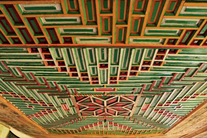 A vibrant and colourful wooden ceiling at the old palace.