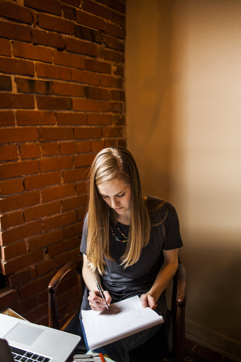 Amanda Olson of Anchor ‹A› Digital Design Co. drawing out website sketches.