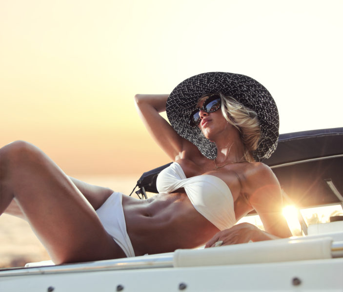 Woman lounging on a yacht