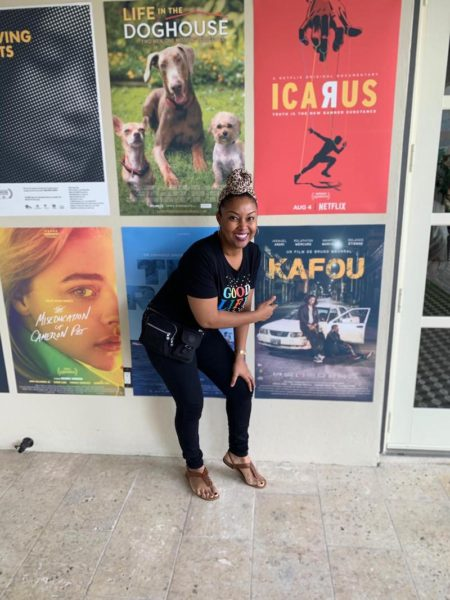 Rogan Smith poses with Kafou film poster