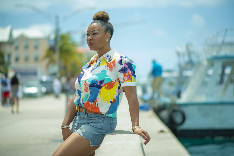 Bahamian Blogger, Rogan Smith poses in Downtown Nassau. The Bahamas reopens for travel on July 1.