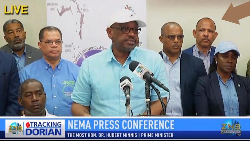 Former Health Minister, Dr. Duane Sands stands behind Prime Minister Dr. Hubert Minnis during a national news conference on Hurricane Dorian last August. (Screenshot/ZNS News)