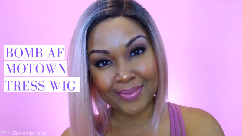 Motown Tress @ThisBahamianGyal blogger Rogan Smith poses with a wig on her head