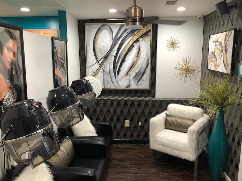 Interior photo of Studio Chique's salon. Photo shows hooded dryers.