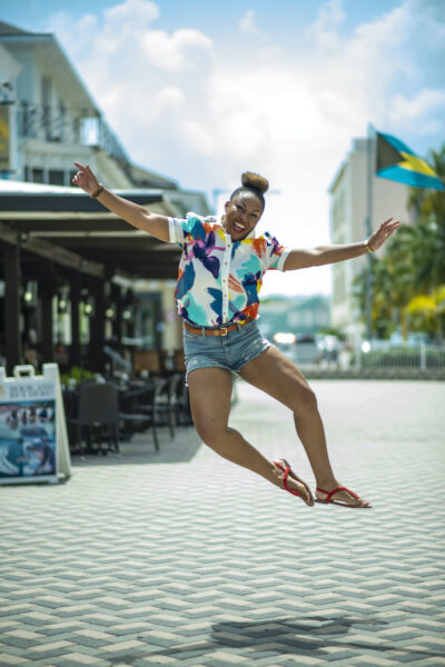 This Bahamian Gyal blogger, Rogan Smith jumps for joy because The Bahamas reopens for travel on Wednesday. Photo/T. Glinton Photography)