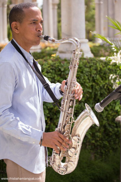 A saxophone player plays Luther Vandross' So Amazing at This Bahamian Gyal blogger, Rogan Smith's eighth wedding anniversary at their vow renewal ceremony in The Bahamas.