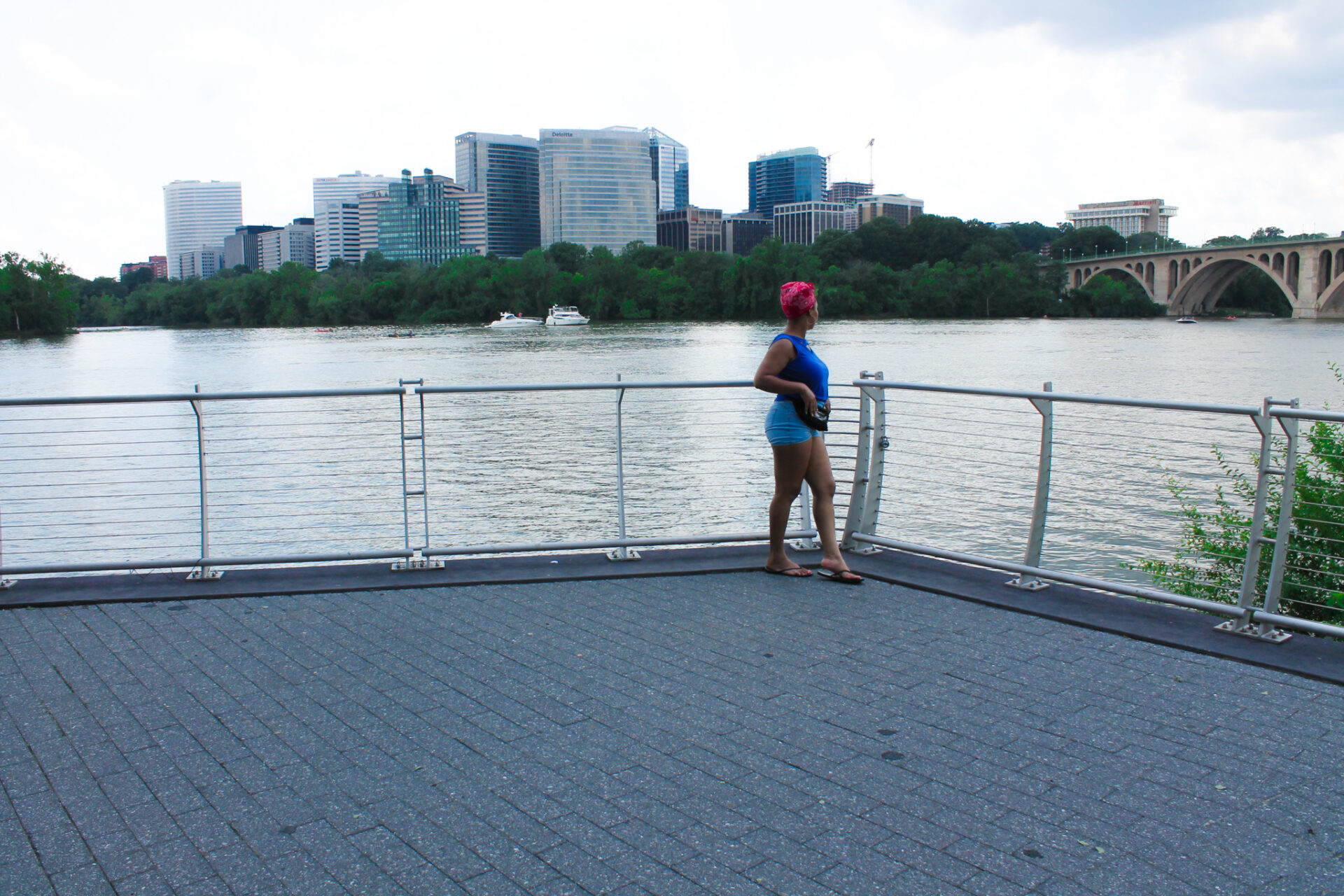 DC blogger, Rogan Smith glances at the Potomac River in Georgetown, DC.