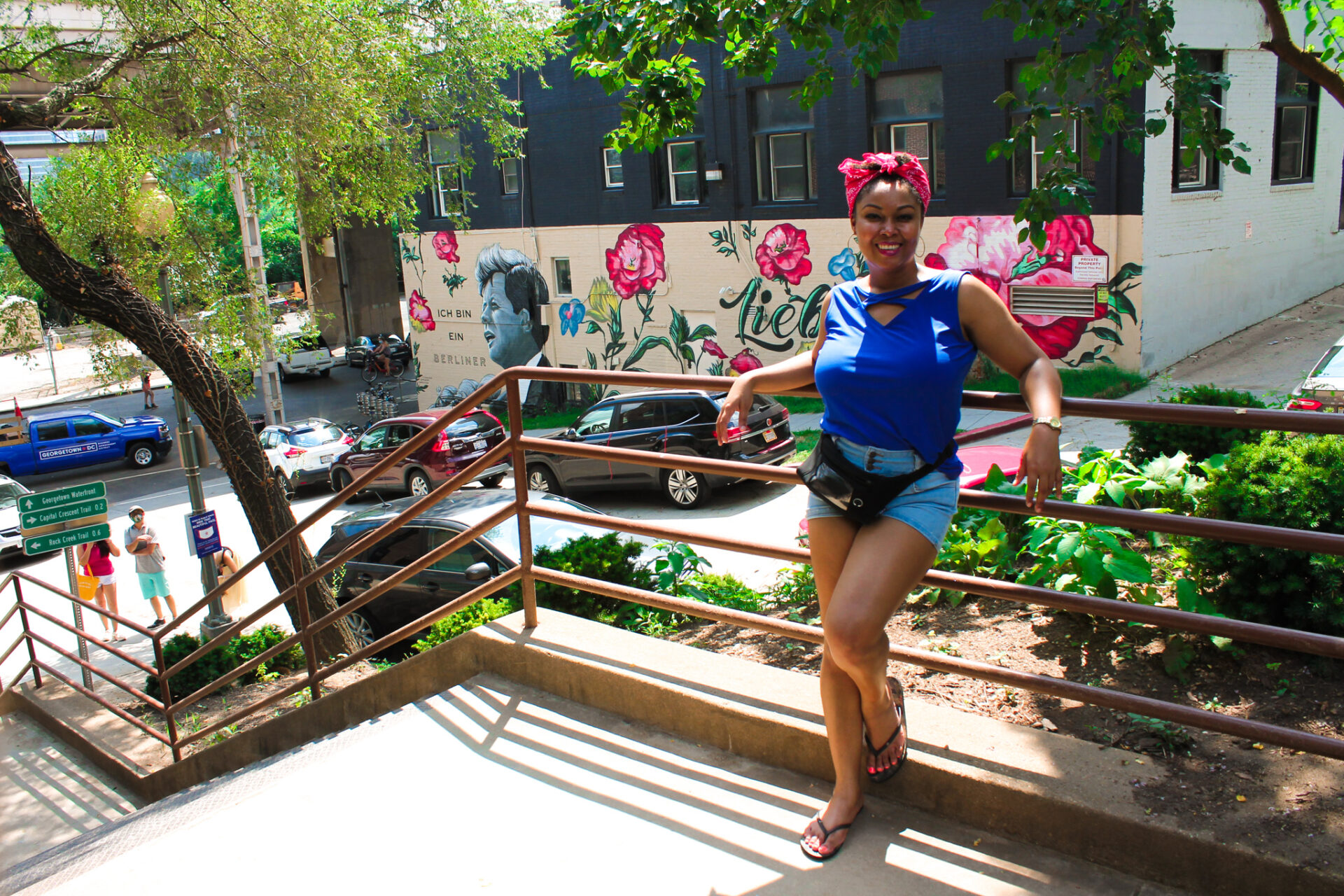 This Bahamian Gyal blogger, Rogan Smith poses in front of JFK's Ice bine in Berliner mural in Georgetown.