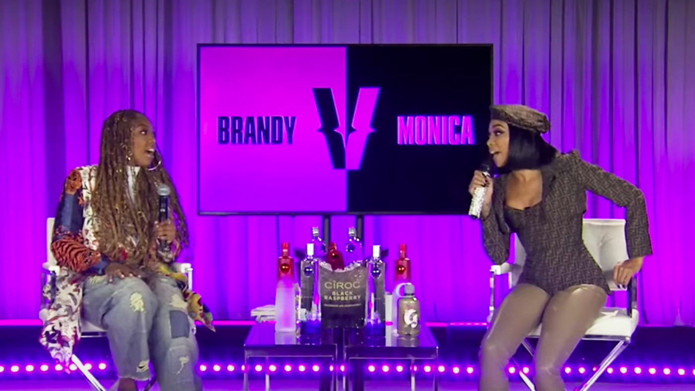 Singers Brandy and Monica sit on the set of their verzuz battle.
