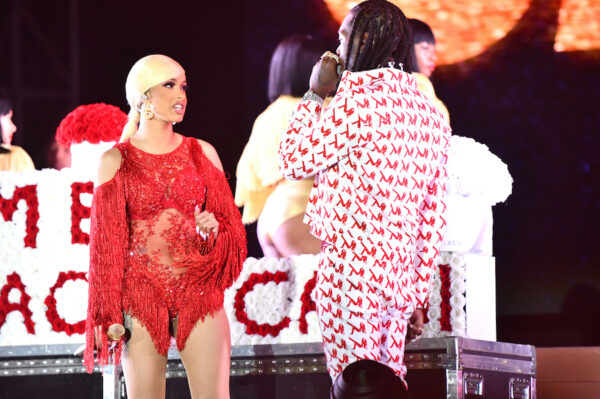 Rapper Cardi B is presented a 'Take Me Back' card onstage by Offset during day 2 of the Rolling Loud Festival in California.