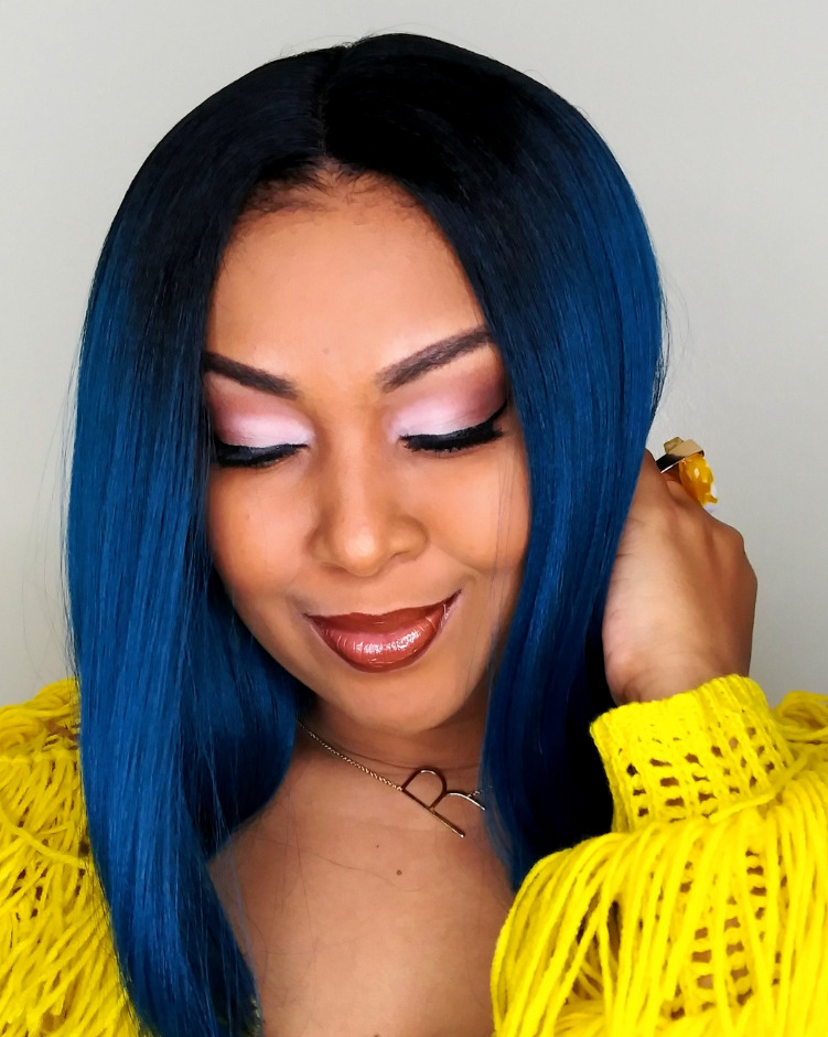 This Bahamian Gyal blogger, Rogan Smith wears a Bobbi Boss premium synthetic wig in teal.