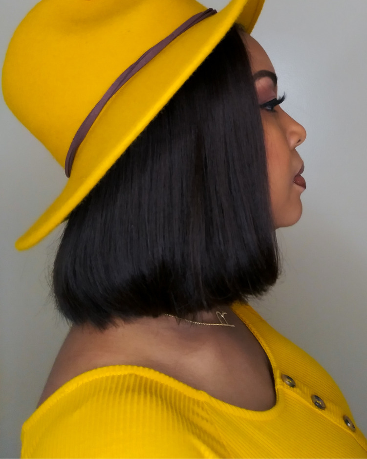 A side view of this mustard Universal Thread fedora.