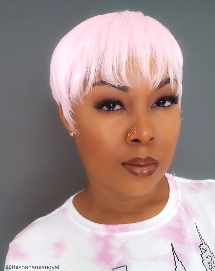 This Bahamian Gyal blogger, Rogan Smith wears a beautiful pink pixie cut wig in this photo.