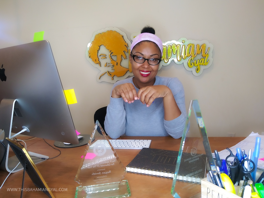 Washington, DC-based blogger, Rogan Smith of This Bahamian Gyal sits at her computer desk blogging.